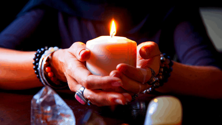 Decorative image of a woman holding a magic candle
