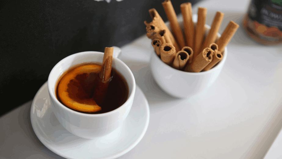 Decorative image of cinnamon money tea for prosperity magick