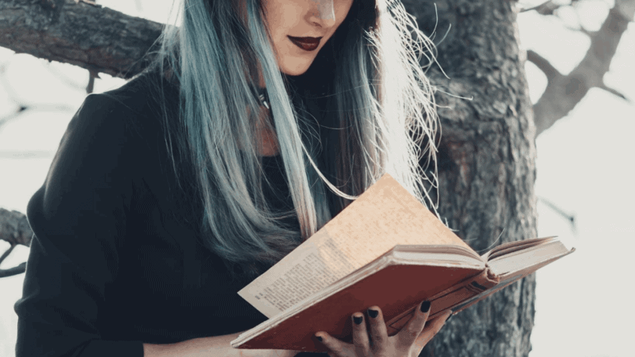 Decorative image of a witch reading a book