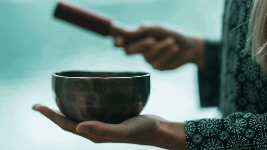 Decorative image of a person using Himalayan singing bowls