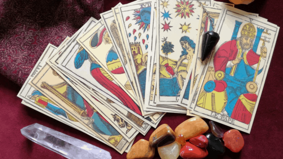 Decorative image of tarot cards and crystals