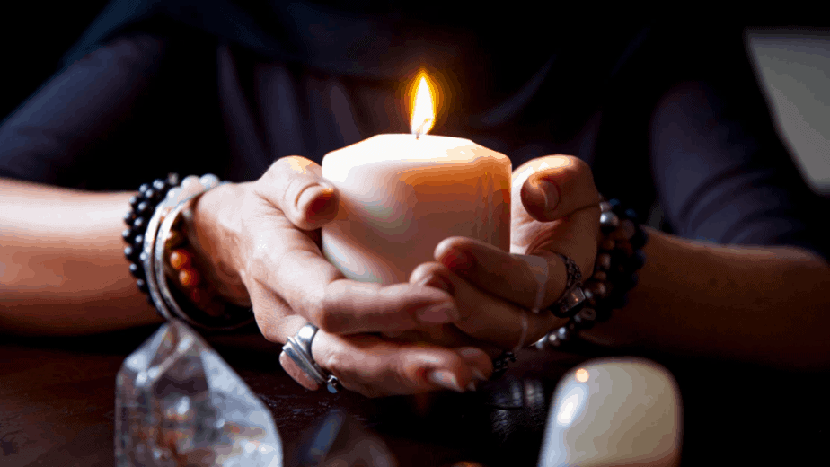 Decorative image of a witch holding a candle