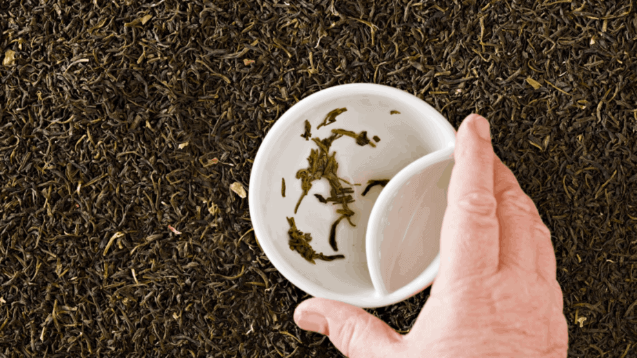 Decorative image of tea leaves in a tea cup
