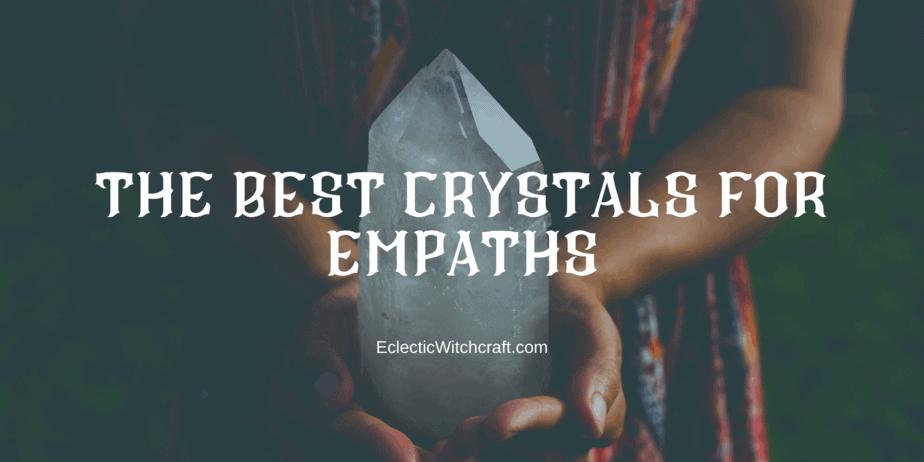 A woman holding a huge quartz crystal