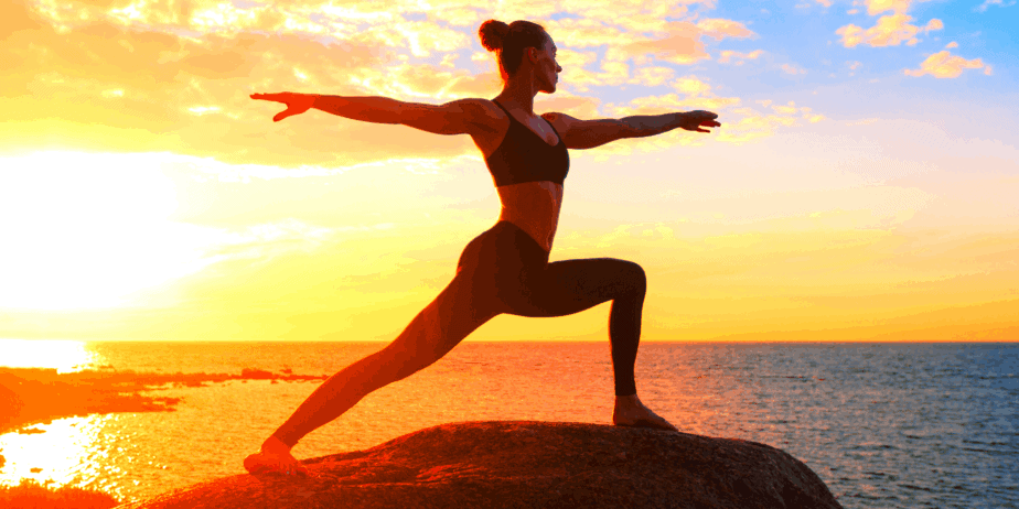 Woman doing yoga against a sunrise header for blog post