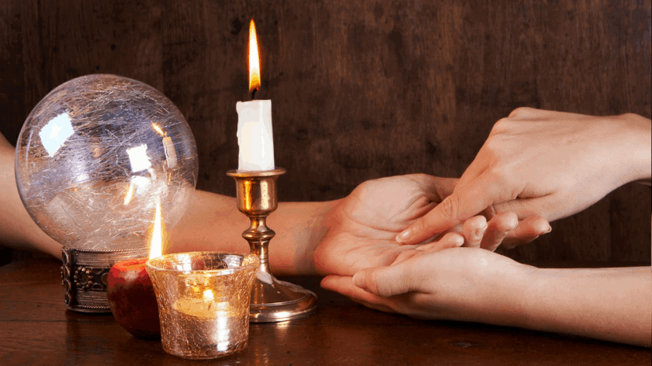 Decorative image of palm reading by candle light