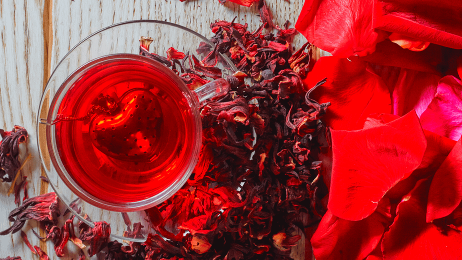 Decorative image of bright red herbal tea made from hibiscus and rose petals
