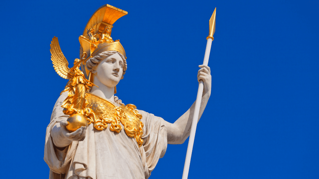 Decorative image of a statue of Athena holding a smaller statue, decorated with gold and holding a gold tipped spear
