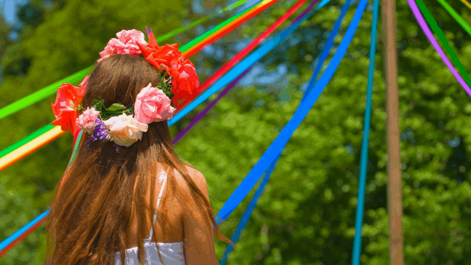 Decorative image of a girl looking at a maypole