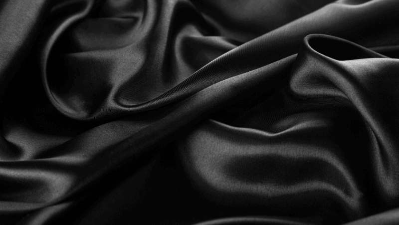 Decorative image of black satin. Why witches wear black.