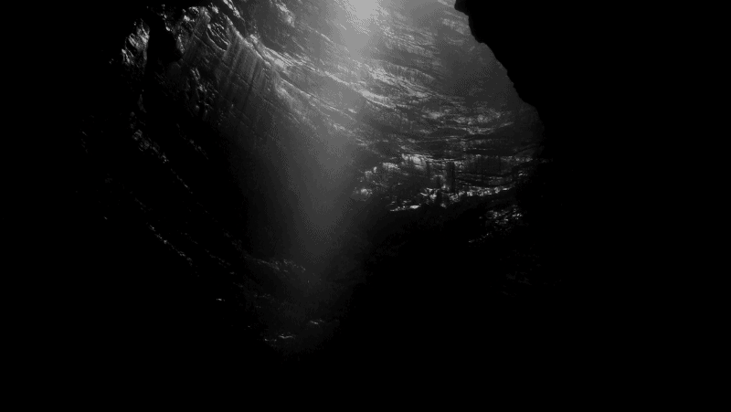 Decorative image of a cave in black and white. Color meanings in different cultures.