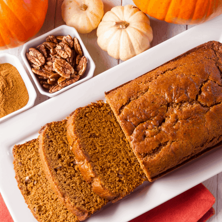 Decorative image of pumpkin bread with walnuts and pumpkins
