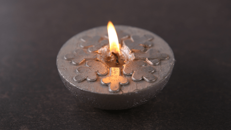 Decorative Image Of a silver snowflake candle