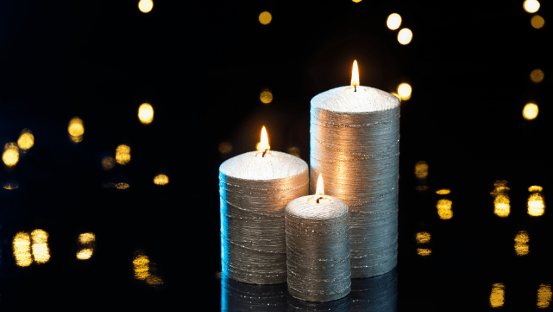 Decorative Image Of silver candles with bokeh background