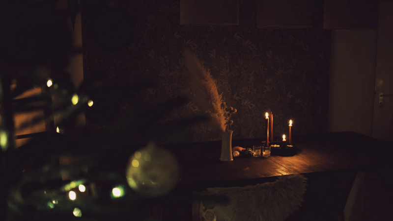 Decorative Image Of candles on a low lighting dining room table at Christmas