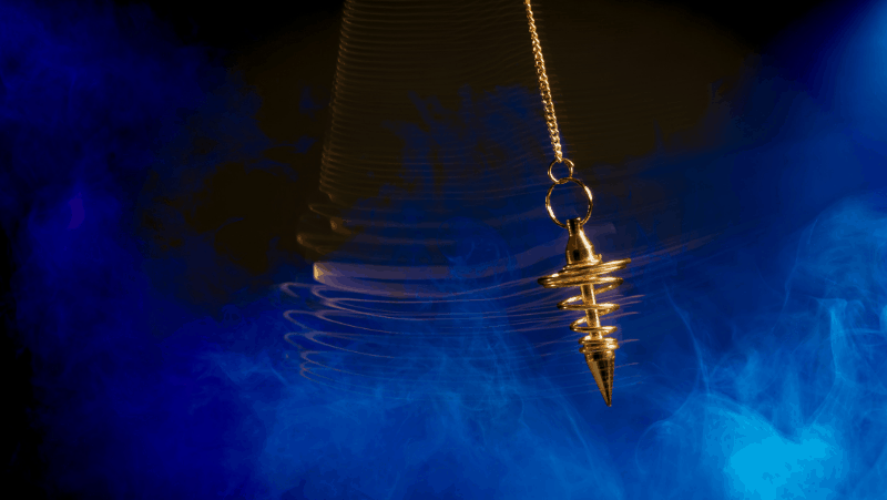 How to get rid of a pendulum: A swinging gold pendulum against a blue and black background