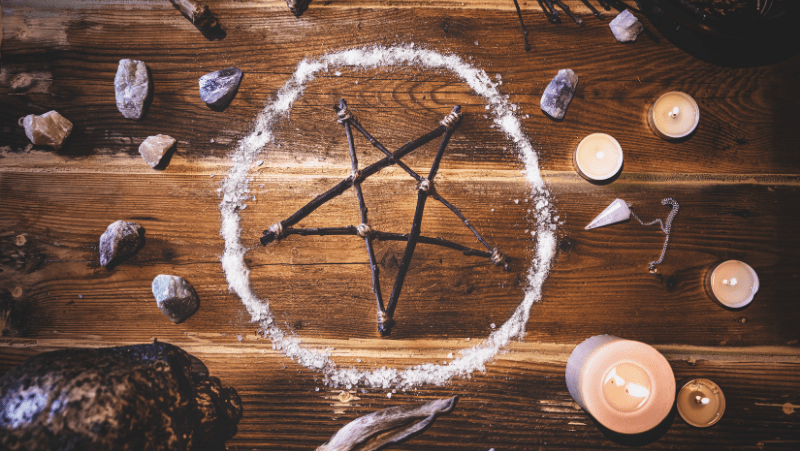 The Wiccan symbol of the pentagram and pentacle and a salt circle for protection