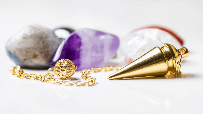 A golden pendulum and crystals