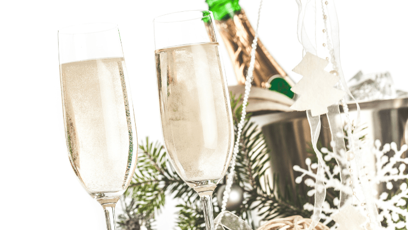 Champagne and Champagne glasses with new year's decor