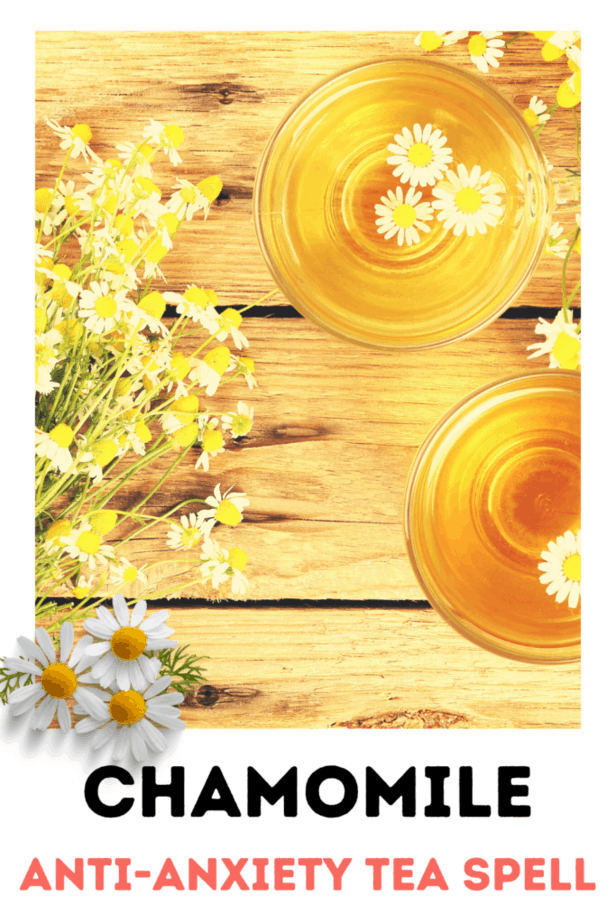 Chamomile tea spell for anxiety with chamomile flowers on a wooden board.
