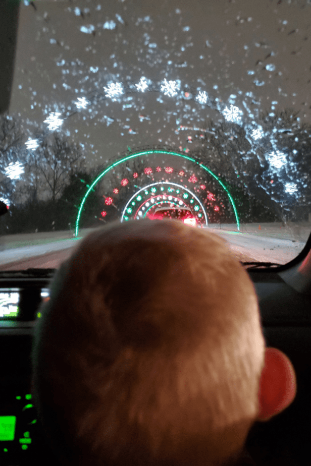 A tunnel of lights at the Lightfest at Hines Park in Westland Michigan with my son admiring the lights from the car.