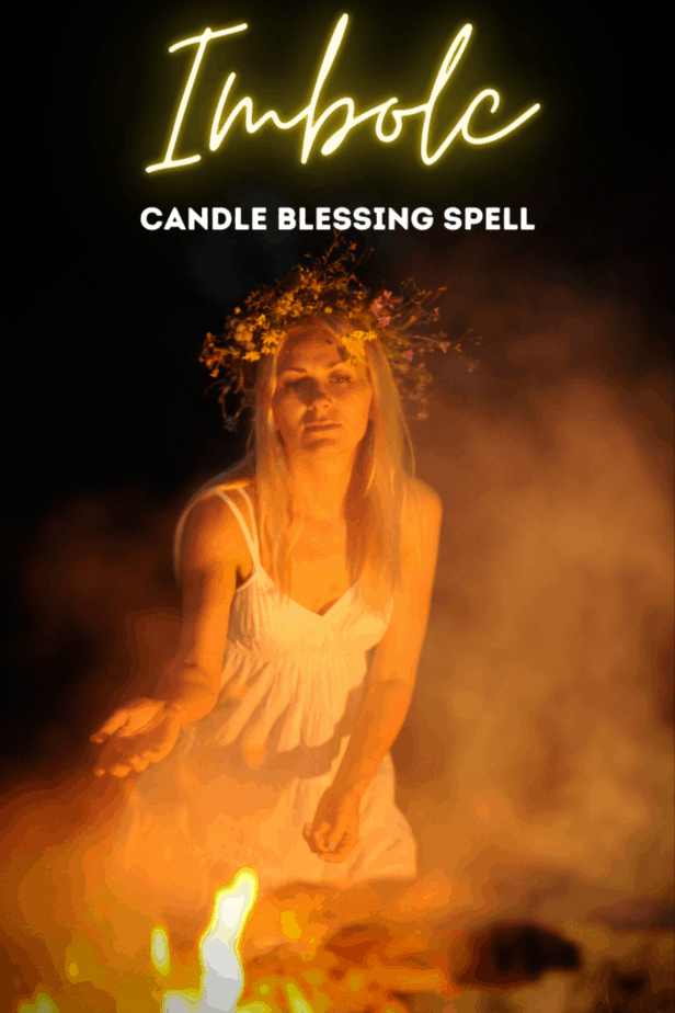A pagan woman over a fire celebrating Imbolc in the dark.