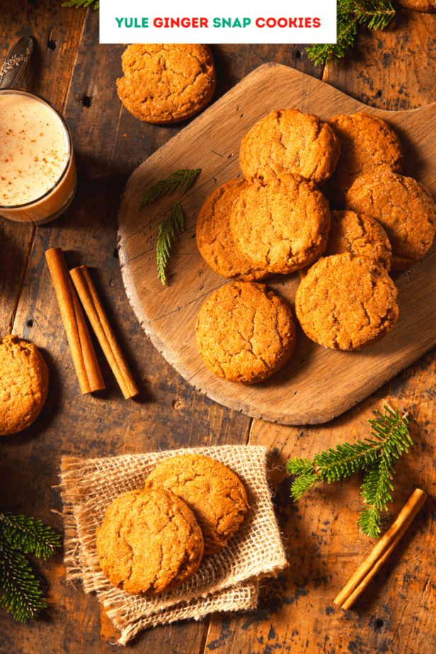 Golden gingersnap cookies with cinnamon, pine needles, a latte, and other rustic decor
