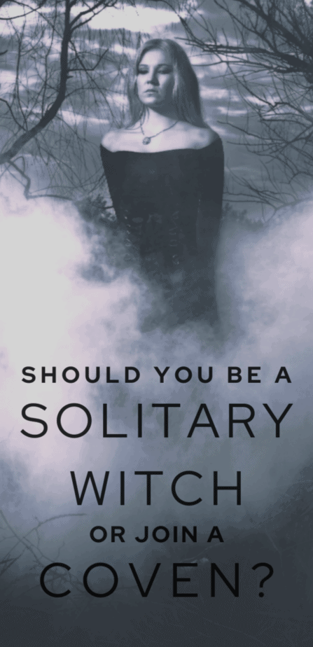 Should you be a solitary witch or join a coven? A witch in a foggy forest wearing a gothic chic dress and necklace looking quite sad