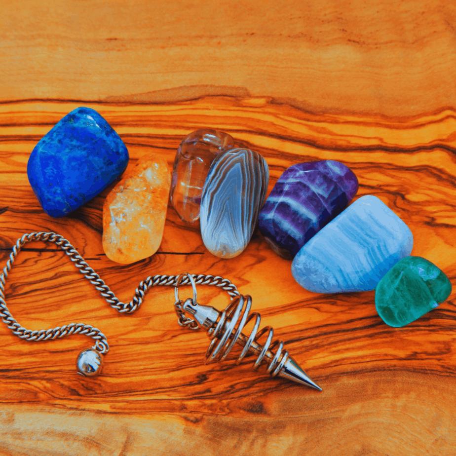 pendulum and crystals on wood