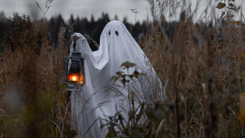 A sheet ghost holding a lantern