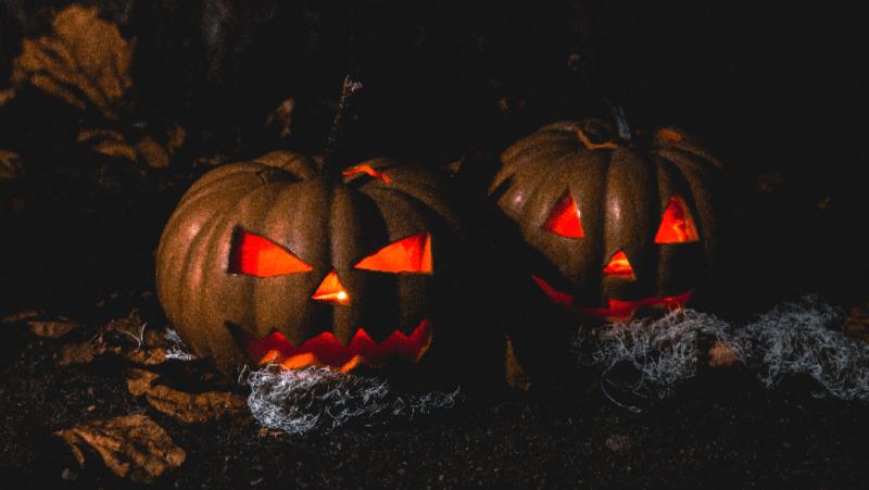 Glowing jack o lanterns in the dark
