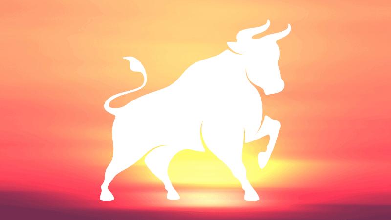 Taurus Sun Bull against a sun gradient